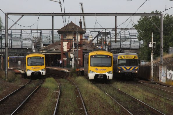 Two down Siemens and an up EDI Comeng at Footscray, the new footbridge lurks behind