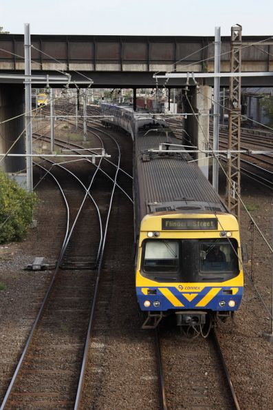 EDI Comeng train passes under the Dynon Road bridge at North Melbourne