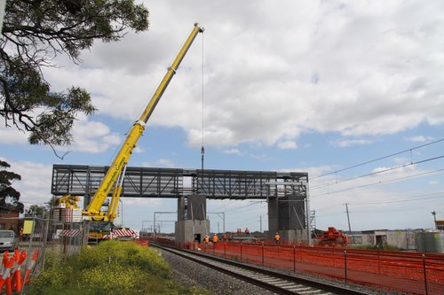 Crane finished putting the new footbridge span into place