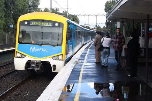 A 'thoroughly clean' Siemens train arrives into Strathmore station to pick up Premier John Brumby and Public Transport Minister Martin Pakula