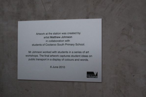 Plaque recognising the artwork created by local schoolchildren on the station lift wells