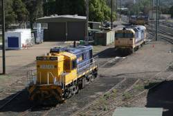 Pacific National 48103 and 8146 stabled in the yard at Cootamundra