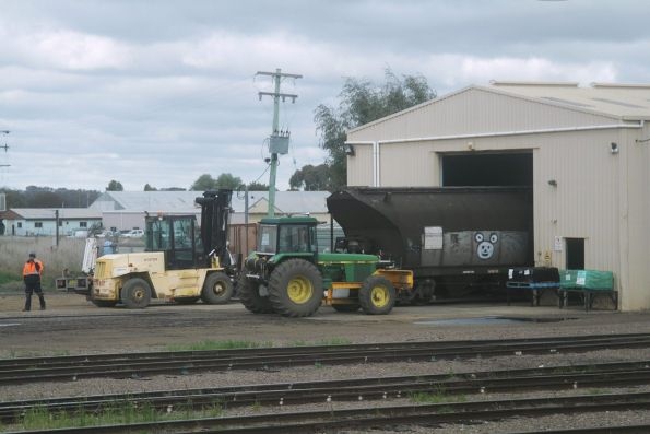 John Deer tractor moving rail wagons around the maintenance facility at Cootamundra