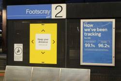'Keep your distance where you can' signage on the platform at Footscray station