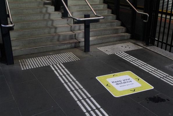 'Keep your distance where you can' signage at the Footscray station stairs