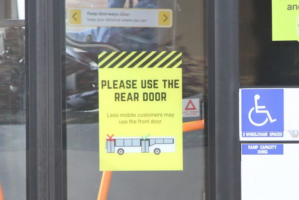 'Please use the read door' signage on the front door of a Sita bus