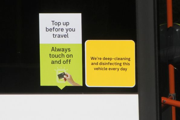 New 'Top up before you travel' message added on the side of a bus