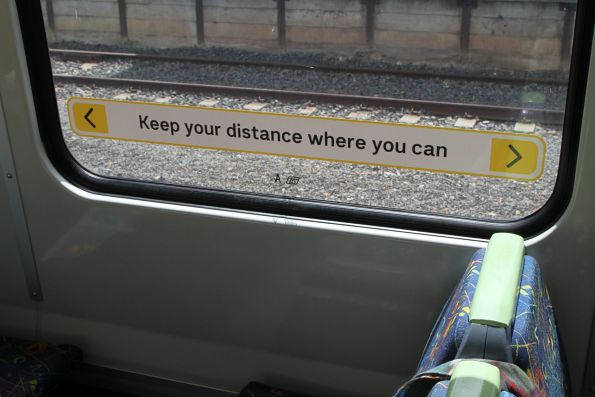'Keep your distance where you can' signage onboard an X'Trapolis train