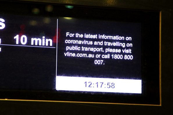 'For the latest information on coronavirus and travelling on public transport' message on a V/Line PIDS