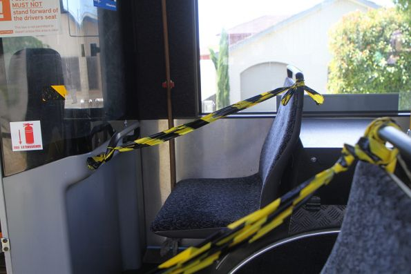 Seats behind the driver taped off onboard a CDC Melbourne bus
