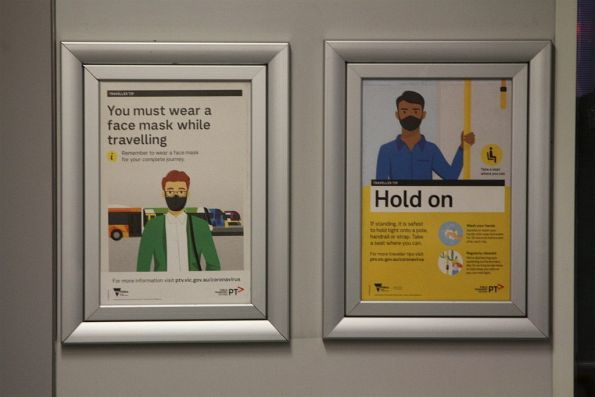 'You must wear a face mask while travelling' and 'Hold on' posters onboard a D1 class tram