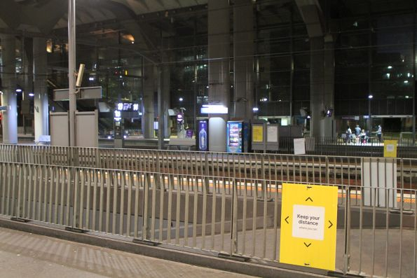 'Keep you distance where you can' signage at Southern Cross Station