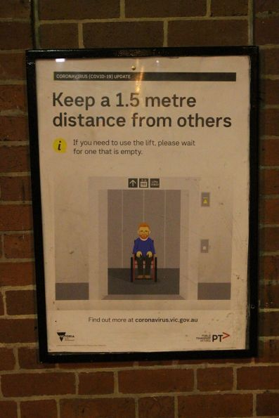 'Keep a 1.5 metre distance from others' sign at Middle Footscray station