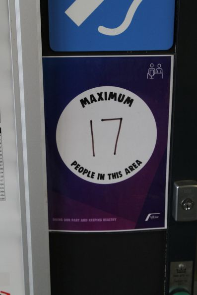 V/Line branded 'Maximum 17 people in this area' signage in the Tarneit station waiting room