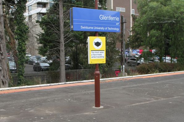 You must wear a face mask while travelling' sign at Glenferrie station