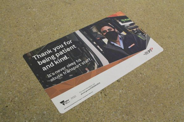 'Thank you for being patient and kind. It's never okay to abuse transport staff' sign on the station floor