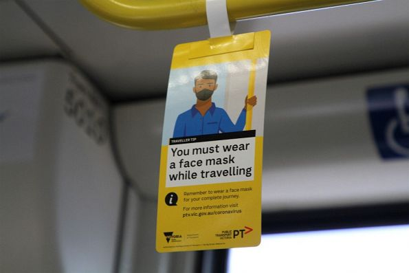 'You must wear a face mask while travelling' flyer onboard a tram