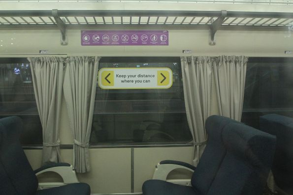 'Keep your distance where you can' window sticker onboard a V/Line train