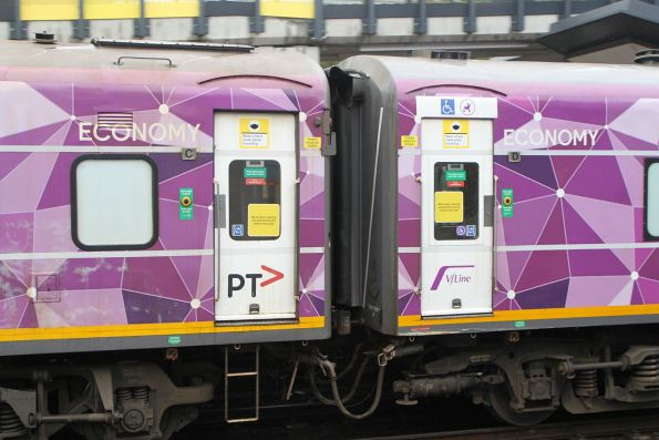 'Wear a face mask while travelling' and 'We're deep-cleaning and disinfecting this vehicle every day' signage covers the V/Line train doors