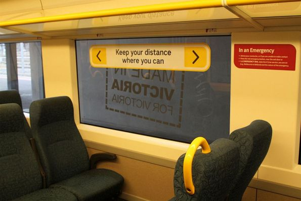 'Keep your distance where you can' window sticker onboard a VLocity train