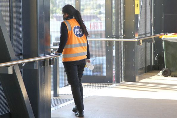 IIS cleaner wiping down the handrails at a railway station