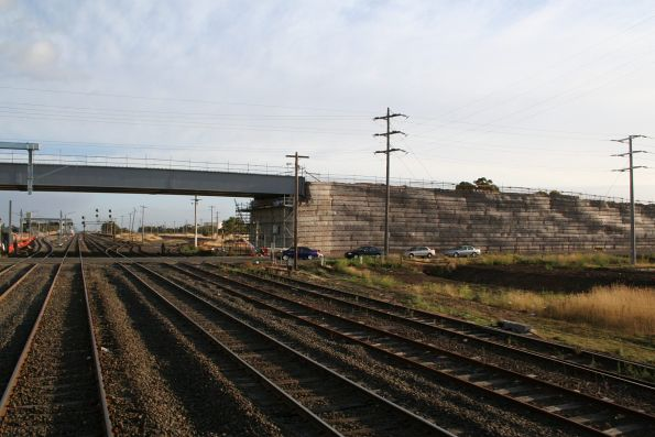 Half of the Somerton Road overpass built, level crossing still in use