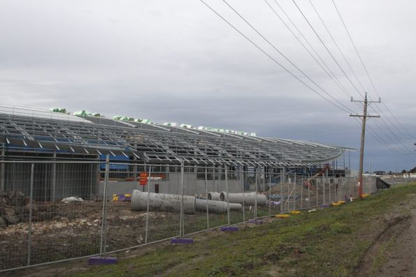 Curved roof being built over the new workshops at Craigieburn