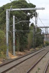 New overhead stanchions in place on the Dandenong tracks at Malvern station