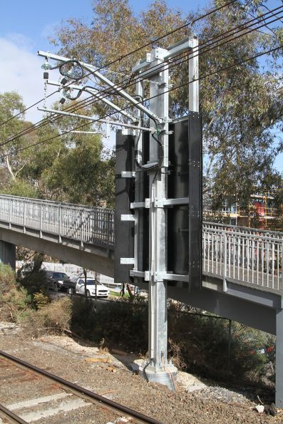 Insulated panels protect the traction power feeders alongside the Yarraman station footbridge