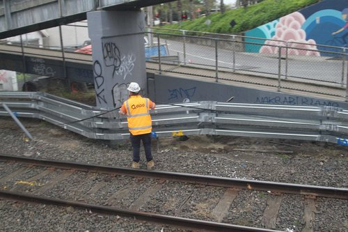 Pulling new signalling cables through trunking at the up end of Oakleigh
