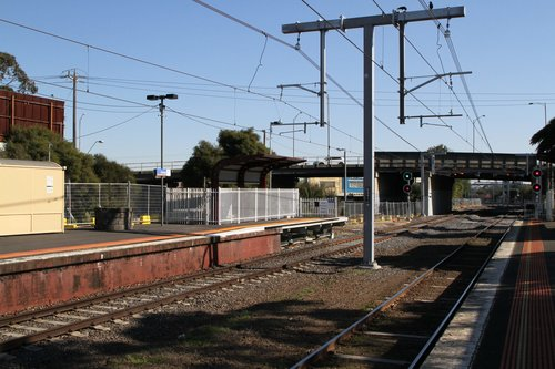 New overhead stanchions in use at Oakleigh station
