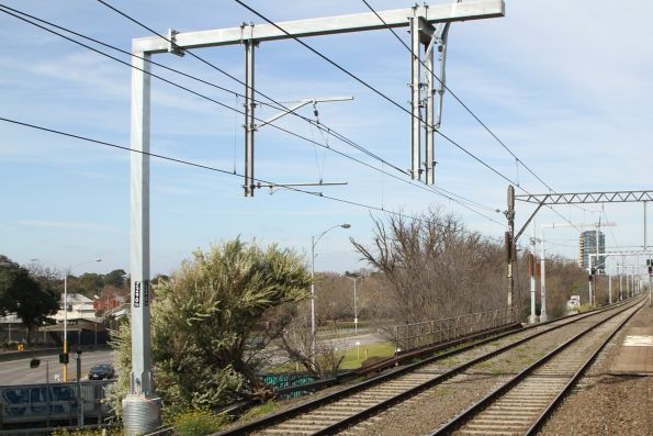 New overhead gantries awaiting commissioning on the Dandenong line tracks at Malvern