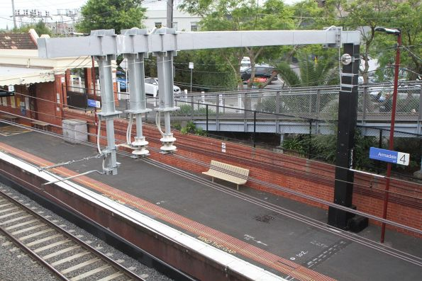 Additional traction power feeders between the tracks at Armadale station
