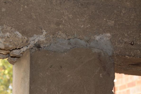 Patched up concrete between beams and piers