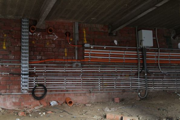 New electrical conduits installed beneath the damaged station building