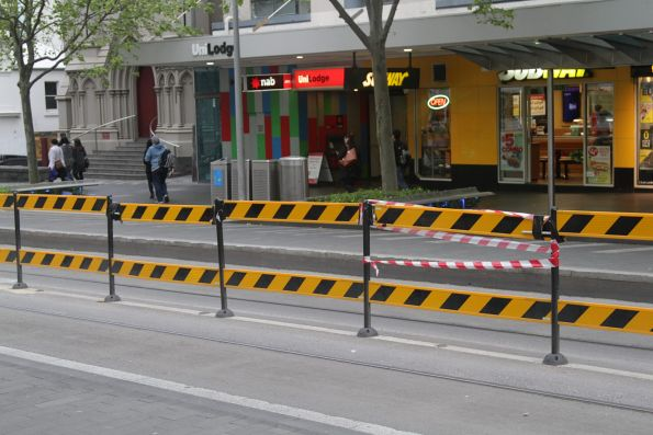 Damaged tram stop fencing at the State Library stop on Swanston Street