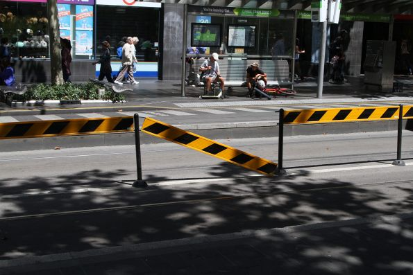 Broken tram stop divider fencing at the State Library