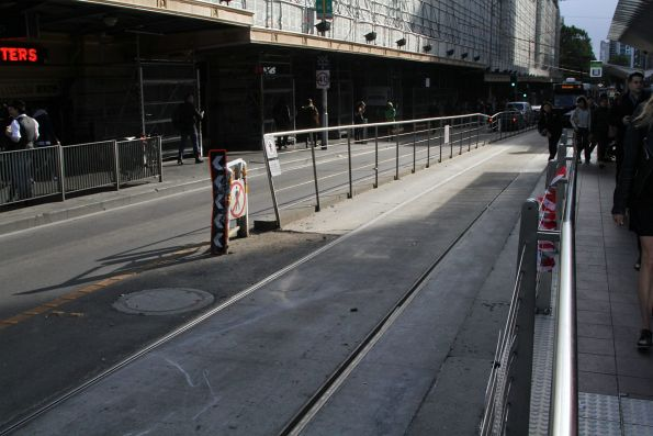 Damaged tram stop fence at Flinders and Swanston Street