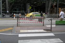 A car has demolished the fence at the Collins and Spencer Street tram stop