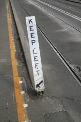 Damaged 'Keep left' sign beside the tram tracks at Queensbridge and Power Street