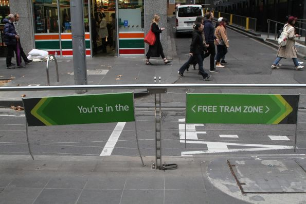 Damaged 'You're in the free tram zone' sign at Collins and William Street