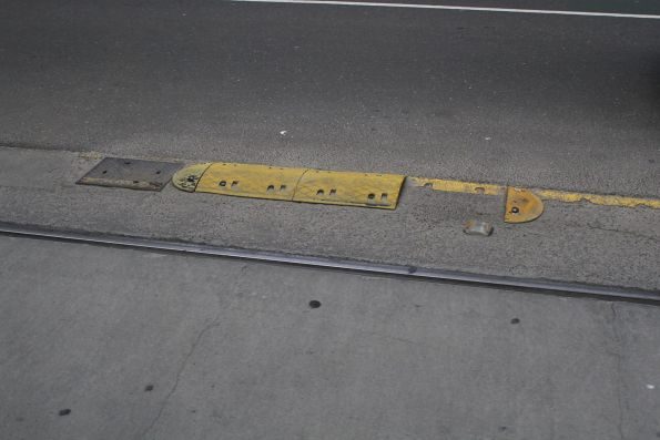 Broken section of yellow plastic kerb along the tram tracks on Bourke Street