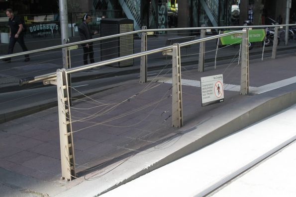 Smashed up fence at the Bourke and William Street platform stop