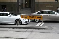 Damaged 'Tram stops' sign at Collins and William Street