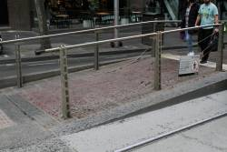 Fence still smashed up at the Bourke and William Street platform stop
