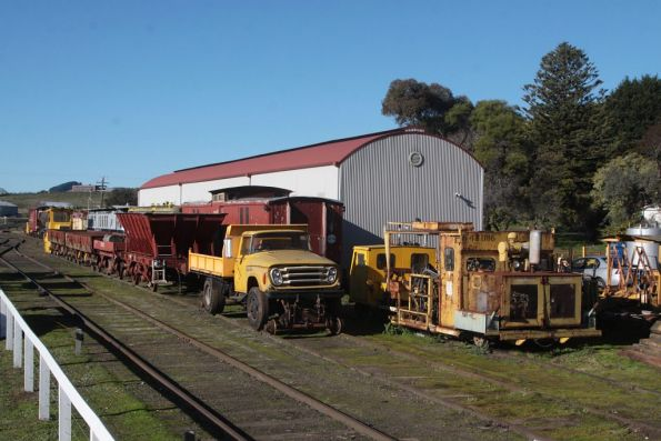 Track machines and wagons stabled in the yard at Daylesford