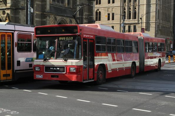 Dee Decker Tours articulated bus 8432AO at Flinders and Swanston Street