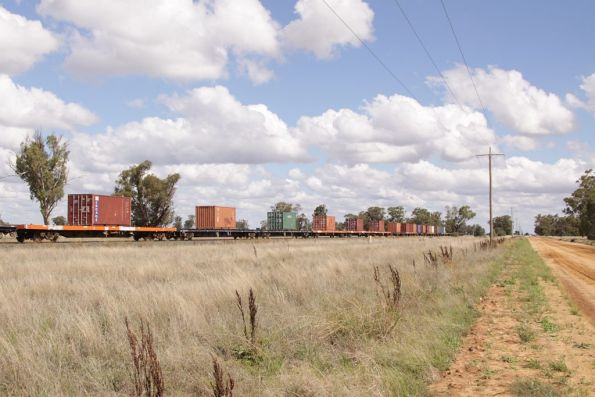 A mix of ex-ANR container wagons carry the containers