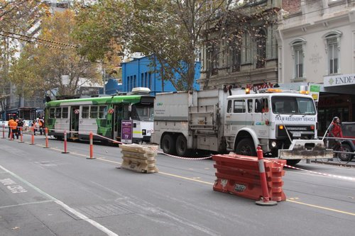 Recovery vehicle R10 ready to pull tram Z3.229 back onto the rails