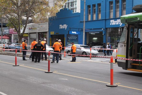 Yarra Trams staff inspect the temporary crossover that derailed Z3.229